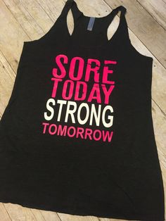 Sore Today Strong Tomorrow Racerback tank with neon text. Sure to make any workout fun! Features: - Premium Neon vinyl text - Tri-blend material for a super soft feel - pre-washed fabric for reduced s