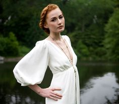 "1970's Inspired Deep V neck Gown, ""Adele"" Bridal Gown, Full 3/4 Sleeves, Column Shape, bohemian wedding dress, minimal, Silk, Customizable. $798.00, via Etsy."