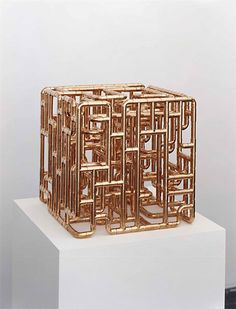 Beautiful cube sculpture from copper pipe fittings