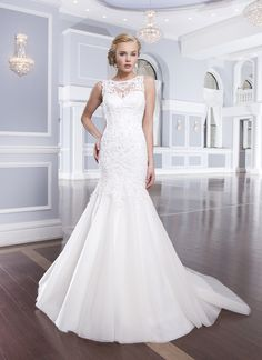 Lillian West lillian west style 6315 Beaded embroidered lace and tulle mermaid features jeweled neckline and  high illusion back. Style is finished with a sweep length train and back  is enclosed by fabric buttons.