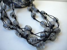 Knotted glass bead multi-strand necklace in gray and black