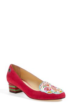 Part of Charlotte Olympia's Mexico-focused Resort 2015 collection, this vivid suede pump is done up in an arrestingly vivid, Day of the Dead motif—complete with a signature spider.