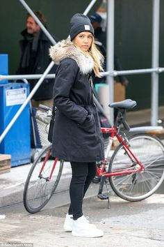 Youthful: Jessica Alba cuts a youthful figure in New York City as she steps out in jeans and trainers while keeping warm with a beanie hat and fur collar coat