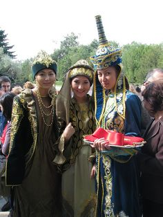 Kazakh young female helpers in national dress attend to the ribbon cutting ceremony at the Kazakhfilm studios in Almaty on the second day of the Eurasia Film Festival 201 Folk Costume, Costumes, Young Female, Traditional Fashion, Central Asia, People Of The World, Kazakhstan, Ethnic Fashion, Festival Outfits