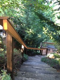 This cool trail leads down to outdoor dining, porch swing and/or fire pit area.