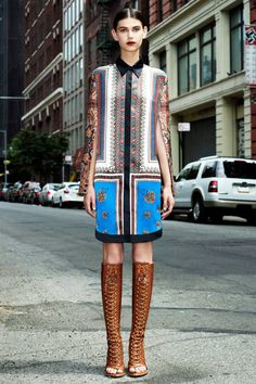 Givenchy gets it so right with this delicate print dress toughened up by edgy knee high boots for the Resort collection.