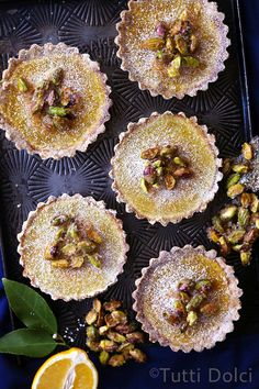 Meyer lemons, brown butter, and two kinds of pistachios (both roasted and candied) take these tartlets to a higher plane.