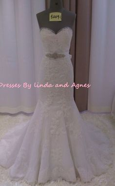 Replica Maggies Sottero wedding dress. Lace mermaid with sweetheart neckline. $670. Please contact us for more information or if you would like to custom design your own dress.