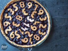 Celebrate Pi Day with... A pie! Simply cut out numbers from the dough and place them on top of the pie before baking. The result is an adorable treat perfect for Pi Day!