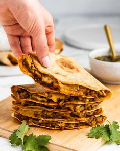 These pork quesadillas with green chile are cooked in the oven on a sheet pan. This is an easy way to make four quesadillas at a time - the tortillas crisp up under the broiler so they're hot, cheesy, and toasty when they come out of the oven. | dinner ideas | pork recipes | mexican food recipes |