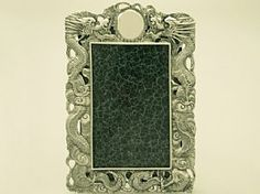 A fine and impressive antique Chinese Export Silver photograph frame; an addition to our ornamental silverware collection  http://www.acsilver.co.uk/shop/pc/Chinese-Export-Silver-Photograph-Frame-Antique-Circa-1890-50p4672.htm