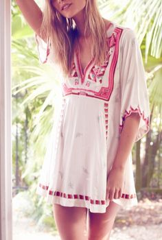 Boldly colored, folk art-inspired embroidery enlivens this free-spirited dress from Free People.