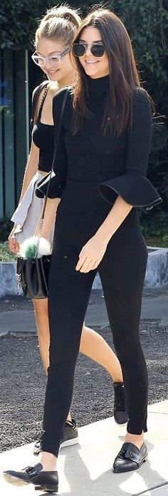 Kendall Jenner: Sunglasses – Ahlem  Purse – Saint Laurent  Shirt – David Koma  Shoes – Camilla and Marc