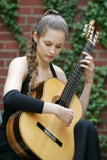 An enchanting publicity photo of Chaconne Klaverenga, guitar (b. 1992)