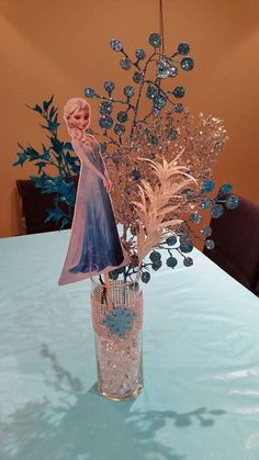Elsa centerpiece at a Frozen birthday party!  See more party planning ideas at CatchMyParty.com!