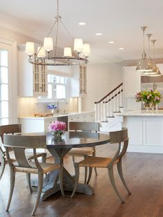 Great Modern Klismos Chairs With Terrific Dining Table: Deluxe Modern Klismos Chairs With Round Dining Table And Pendant Lamps Combined With White Kitchen Cabinet And White Kitchen Island Completed With Wooden Floor And White Staircase ~ kaisahan.net Contemporary Home Design Inspiration