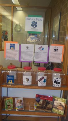 """""""Book = Bead"""" Read a book, receive a bead, pick a charity. The charity with the most beads at the end of program will receive a donation from the Library."""