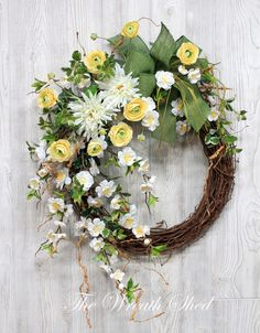 This is such a beautiful spring wreath, or summer! Loving the yellow Ranunculus with the white spider flowers, it'll be perfect on my front door. Adds a bit of curb appeal on a budget ; Summer Door Wreaths, Wreaths For Front Door, Spring Wreaths, Ranunculus Flowers, White Cherry Blossom, Country Wreaths, Flower Lights, Front Door Decor, Grapevine Wreath