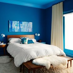 This bedroom is essentially as close as you can get to comprehending the feeling of being comfortably submerged in a peaceful body of water without having to worry about breathing. Like a cozy lil beta fish ready to dive into those sheets and just dream in shades of blue. #ooooo #ahhhhh // Design by @eggandchrome of #HomepolishCHI + photo by @dustinforest. New home tour up on the #HomepolishMag. [LINK IN PROFILE✨]