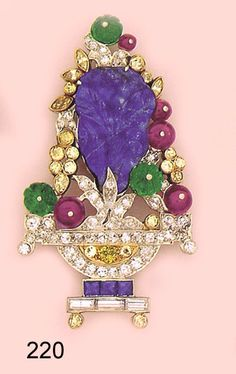 Art Deco Brooch, Carved lapis lazuli, carved emerald, ruby bead,  calibre sapphire, canary diamond and platinum flowerpot brooch.