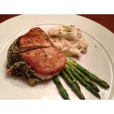 Center cut pork-chops stuffed with spinach, goat cheese and sun dried tomatoes. Garlic Parmesan red potatoes and asparagus.