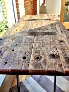 Table made from reclaimed telephone poles. Found at Crate & Barrel by Sarah of @UglyDuckling