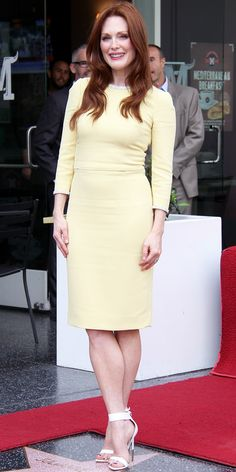 10/04/13: At the Hollywood Walk of Fame, Julianne Moore was honored with a star and wore a lemon-yellow Dolce & Gabbana dress with an embellished neckline and cuffs for the occasion. She accessorized with white ankle-strap Givenchy heels. #lookoftheday