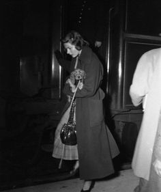 0 ingrid bergman holding her dog in hers arms