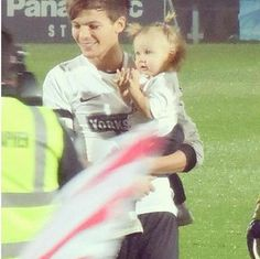 Is Lou trying to kill me with holding baby lux please let me be while i fall on the floor of cuteness