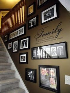 Picture frames on stair wall #family #photos