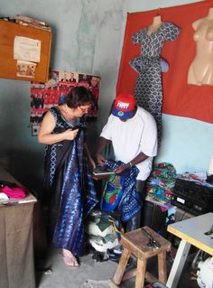 Giving instructions to Lamin about how to sew the indigo dress