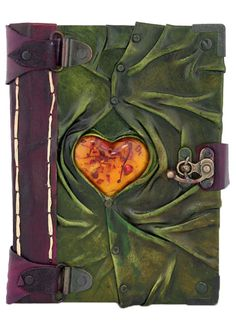 Unique handmade leather journal with a Medium 3D Heart Decorated on the front cover. This great piece of art is combined with a Journal which can also be used as a notebook. The paper used in the Journal is top quality Persian Paper and can be used for both sketching and writing.