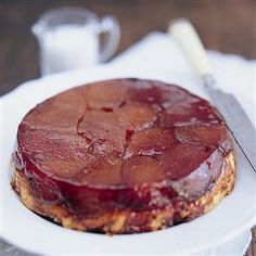 Tarte Tatin - tart apples, sweet oozing caramel on a crisp pastry erved warm with clotted cream - perfecto!