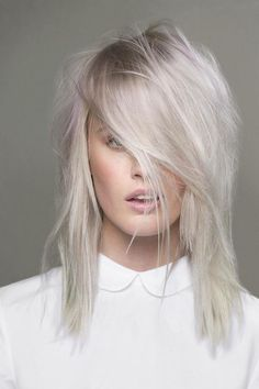 Platinum Blonde Layered Shag Meduim Length Hair With Side Layered Bang