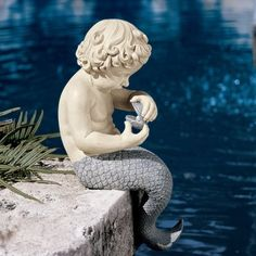 Find the perfect statues & sculpture for your garden or outdoor patio on Wayfair. Browse through a large selection of beautiful statues & sculptures! Mermaid Sculpture, Mermaid Statue, Mermaid Boy, Fish Garden, Statue Tattoo, Merman, Severe Weather, Garden Statues, Tropical Decor