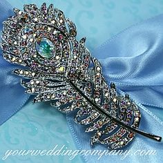 Dress up your bouquet handle, purse or add a sparkling accent to your dress. This brooch is handmade with high-quality, AB Swarovski crystals.