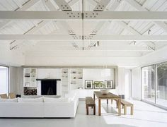 All White Open concept floor plan. Best Modern Lake Houses White Interior