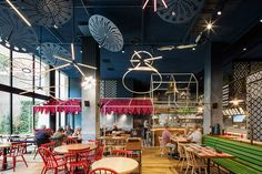 el equipo creativo forms vibrant village setting inside messi's restaurant in barcelona