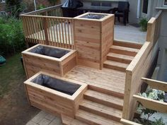 Planters and wide stair landings take the curse off a high rectangular deck.