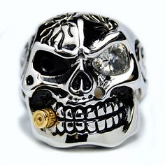 badass ring!! from: http://www.overstock.com/Jewelry-Watches/Stainless-Steel-Cubic-Zirconia-Skull-and-Bullet-Ring/6151323/product.html