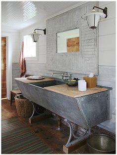 Make your bathroom stand out with a one-of-a-kind vanity. You can put a sink on almost anything! Rescued Cow Trough When New York design firm Carrier and Company converted an old dairy barn into a. Barn Bathroom, Rustic Bathrooms, Bathroom Vanities, Bathroom Ideas, Industrial Bathroom, Industrial Style, Bathroom Cabinets, Bathroom Designs, Bathroom Modern