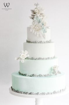 Featured Cake: Winifred Kristé Cake; Wonderful for winter four tier light blue and white wedding cake with silver accents Cool Wedding Cakes, Beautiful Wedding Cakes, Gorgeous Cakes, Wedding Cake Designs, Pretty Cakes, Wedding Cake Toppers, Disney Wedding Cakes, Mint Wedding Cake, Frozen Wedding