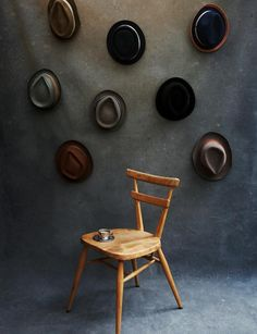 architect, Bill Hanway's hats on gray backdrop, Ercol chair