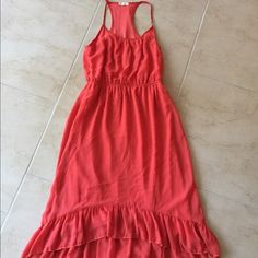 """Francesca's Everly Dress sz 6 Beautiful orange racerback sundress. Brand is Everly sold at Francesca's. 100% polyester. Small spot on bottom front ruffle. Length at longest point from armpit down: 37"""" at shortest point: 35"""" armpit to armpit: 16"""". elastic waist that looks great alone or with belt. Size tag was removed. Everly Dresses"""