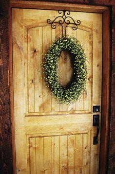Oval wreath on pretty wire hanger  #home #entryway #front_door #wreath
