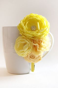 Such a fun spring headpiece. Flower in several shades of yellow. This is on a hard headband but you can select the option to have it on elastic. From top to bottom this flower cluster measures about 5 1/2 to 6 inches.
