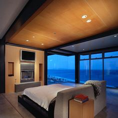 Floating Bed Design in Various Models: Elegant Bedroom With A Stylish Floating Bed With Small Fireplace Design Ideas With Glass Panel For Se. Contemporary Bedroom Furniture, Modern Bedroom Design, Classic Furniture, Small Fireplace, Fireplace Design, Porches, Floating Bed, Loft Style, Awesome Bedrooms