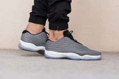 The futuristic Air Jordan Future Low silhouette gets decked out in a cool colorway with gray, black and white. These neutrals perfectly complement the contemporary looking shoe, with its sleek lines a...