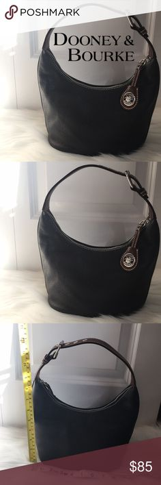 Dooney & Bourke Black Leather Purse!!! Very good used condition. No stains rips or tears. 100% Authentic Dooney & Bourke! Black leather handbag! Super cute and goes with everything! Check out my closet for other name brand items!! Dooney & Bourke Bags Shoulder Bags