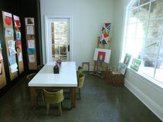 kids' home art studio. great light. JUST FOR THE KIDS....i'd of course have my own :)